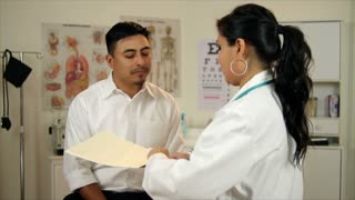 Latino woman doctor talking to paitent