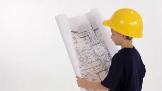 little contractor looking at plans