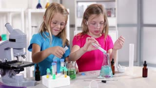 Little girls in a science class