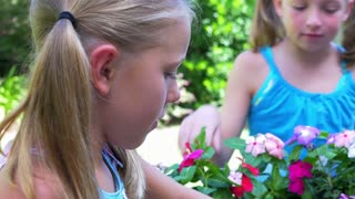little girls planting flowers 4k.