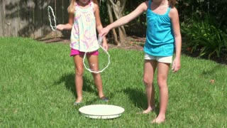 little girls playing with bubbles 4k.