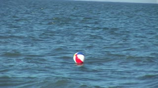 lost beach ball in the surf