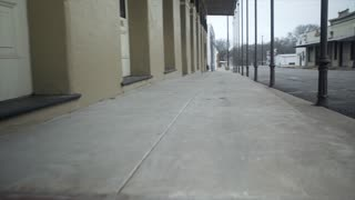 low angle walking along a sidewalk showing very old buildings 4k
