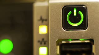macro of a computer power button with flashing lights in the background 4k