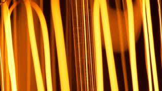 macro of a light bulb filament being dimmed and bright 4k