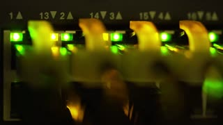 macro of lights blinking from a server ethernet switch 4k