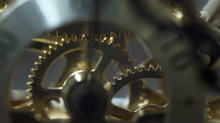 macro of the second hand gears turning in a clock 4k