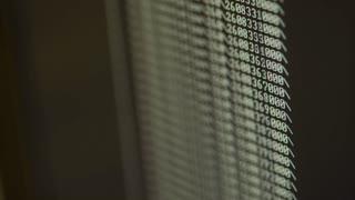 macro shot of a computer monitor showing programing code 4k