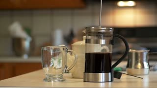 making coffee with a french press slow motion.