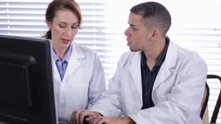 male and female doctors working