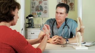 male doctor talks about joint arthritis