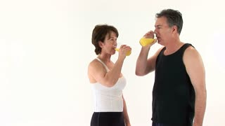 man and woman drinking orange juice