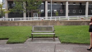 man and woman sit on bench and read newspapers