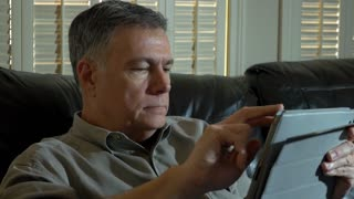 man at home using a tablet pc