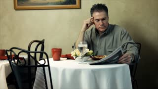 man eating in a restaurant