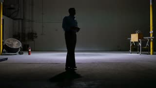 man in a warehouse talking on a cell phone 4k