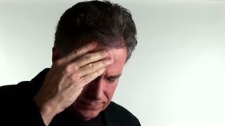 man migraine looks at camera