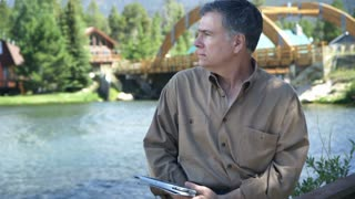 man outdoor using a tablet pc.