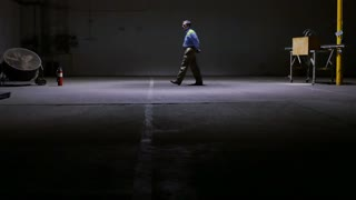 man pacing in a large warehouse 4k.