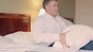 man relaxing in his hotel room