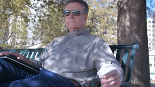 Man relaxing on a park bench