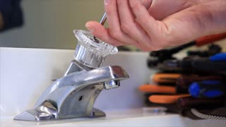 man repairing the faucet