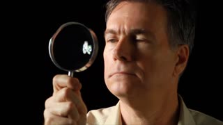 man seaching with magnifying glass