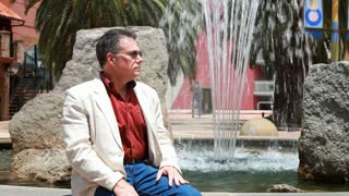 man sitting at the fountain