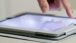 man using a tablet pc close shot
