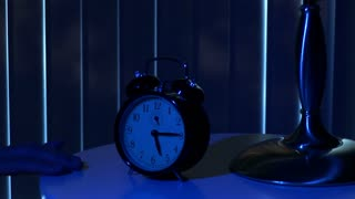 man waking  up to alarm clock