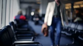 man walks to seat at airport