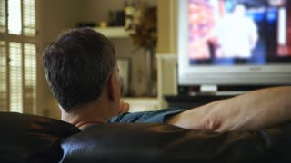 man watching on television