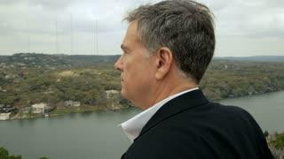 man watching the river below