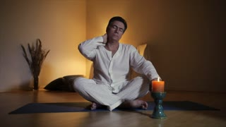 man with neck pain meditates