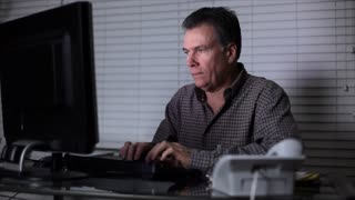 man working at night falling asleep