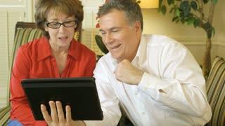 mature couple using webcam