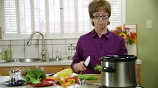 mature woman working in the kitchen.