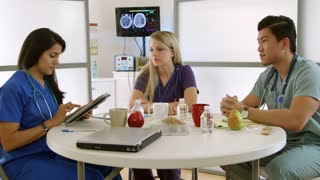 medical interns in hospital break room with tablet