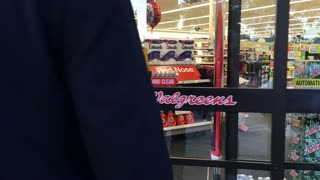 Missouri City, Texas - April 23 2016 man walks into a walgreens store