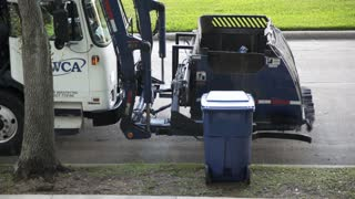 Missouri City, TX - July 1 , 2016 modern efficient and fast neighborhood curb side trash collection