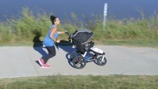 mom jogging and pushing stroller