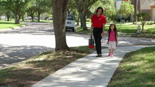 mom walking her young daughter home from school