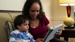 mother playing with her baby using a tablet pc