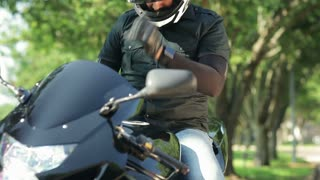 motorcycle rider looking at his phone