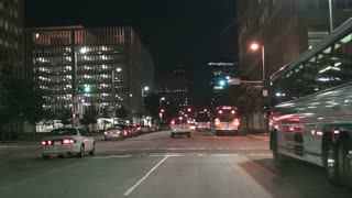 nightime in traffic with metro buses downtown Houston