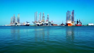 oil rigs and jack up barges in Galveston bay 4k