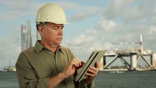 Oilfield worker using a tablet pc
