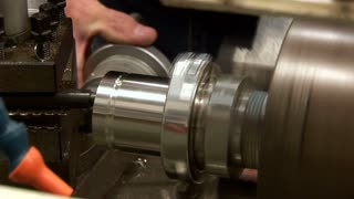 operator using a metal lathe