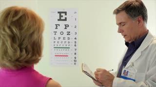 optometrist having his paitent read eye chart