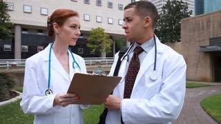 outdoor doctors talking wide shot